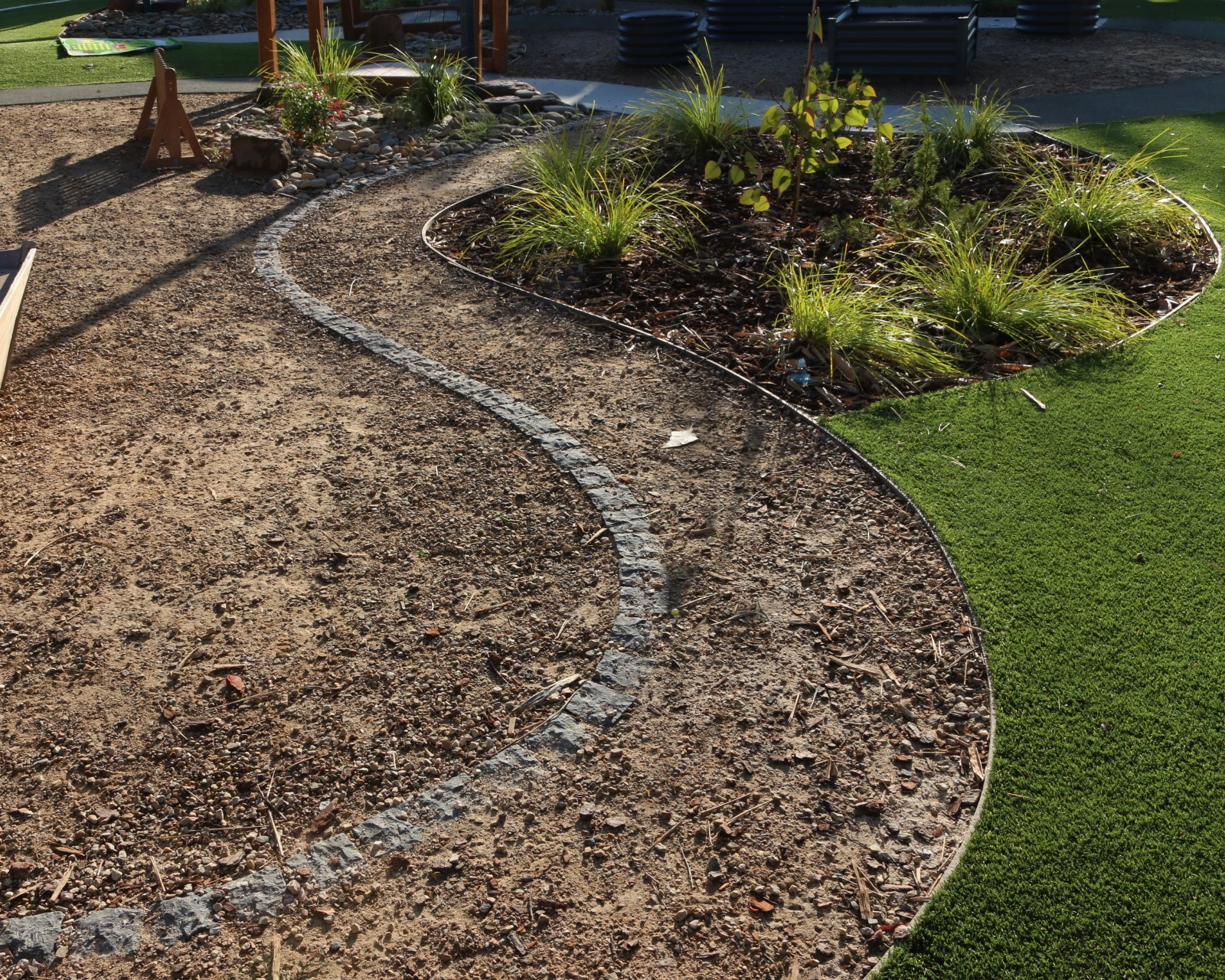 childcare centre Cranbourne - line of cobblestone in compacted toppings