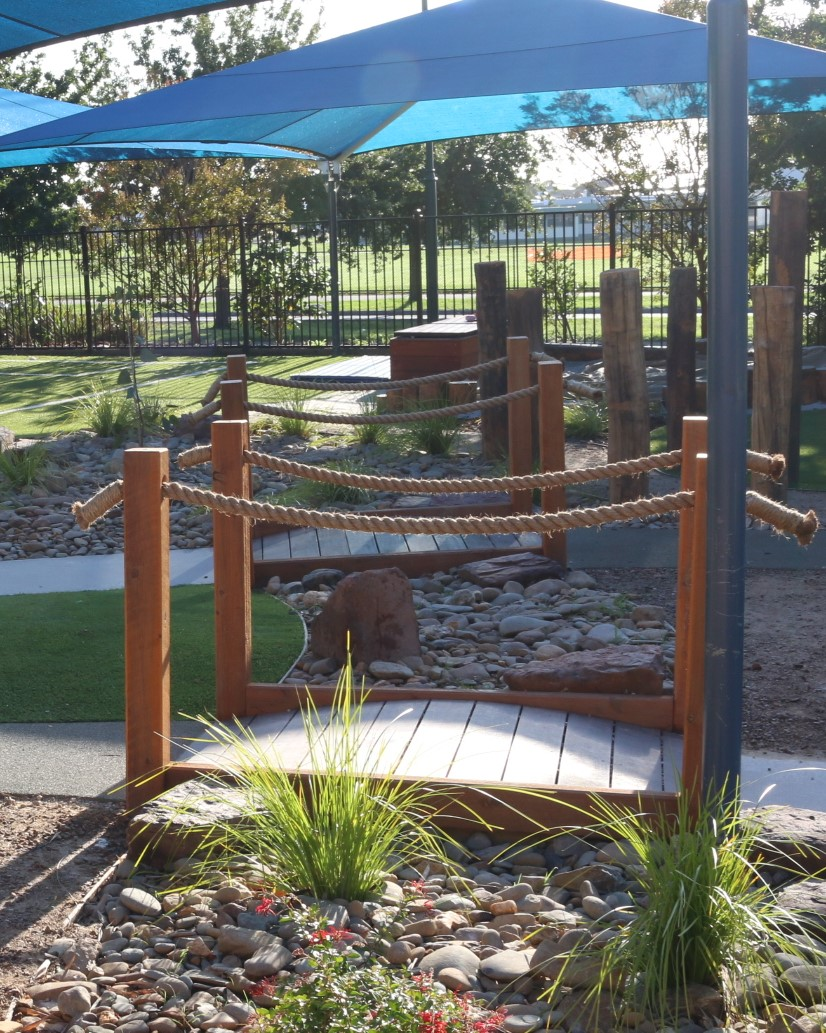 childcare centre Cranbourne - timber arched bridge with rope rails