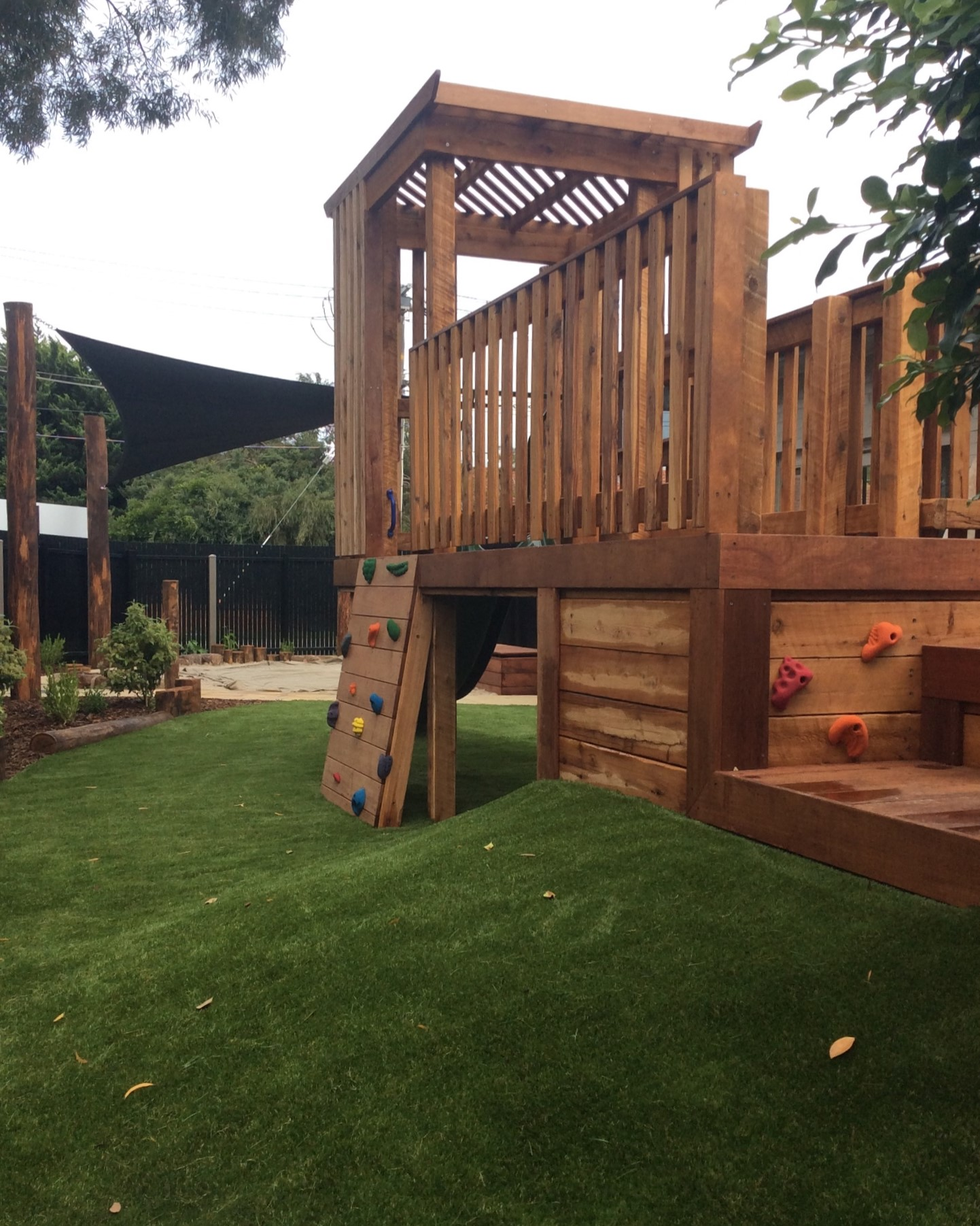 Custom childcare timber fort on mound