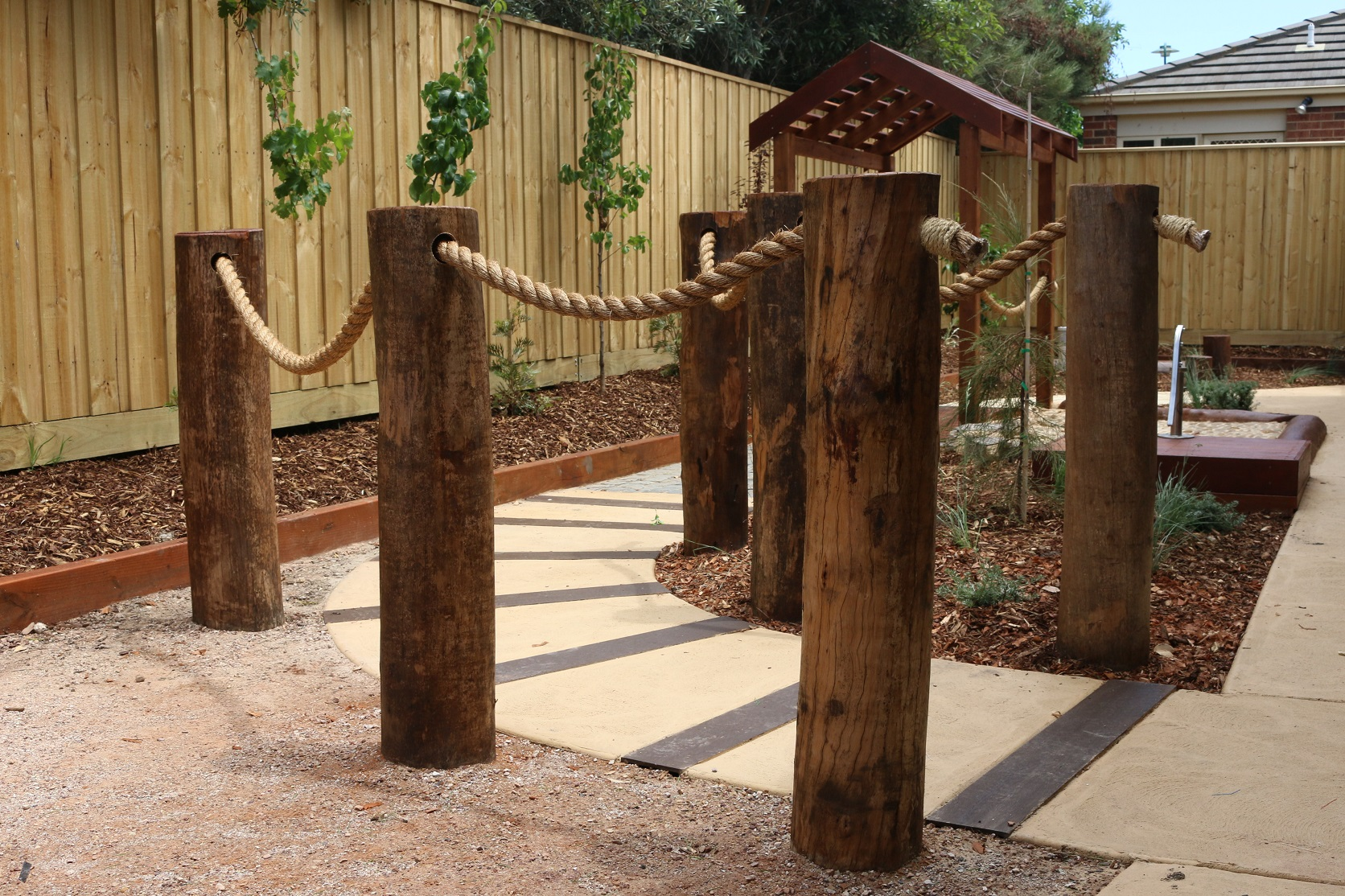 logs sleepers in path - newcomb